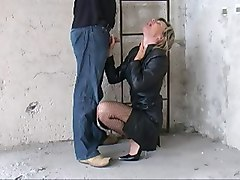 dominatrix in leather gag a slave